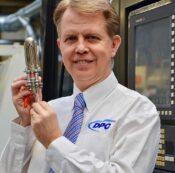 Image of Simon Dawson holding the extinct audio microphone